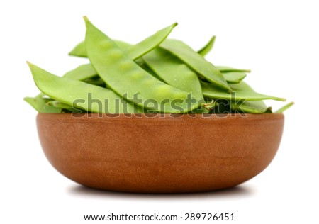 snap peas in bowl isolated on white