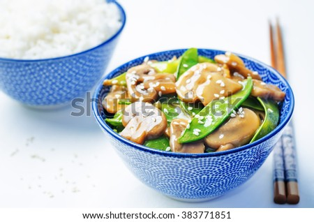 Snap peas Mushrooms Stir Fry on a white background. toning. selective focus - stock photo