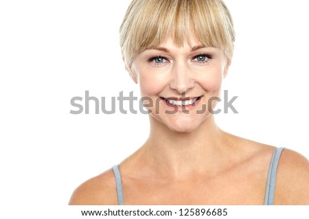 Snap shot of a cheerful sexy blonde in sleeveless spaghetti top. - stock photo