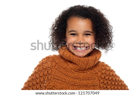 Snap shot of a stylish african girl in winter clothes flashing a warm smile. - stock photo