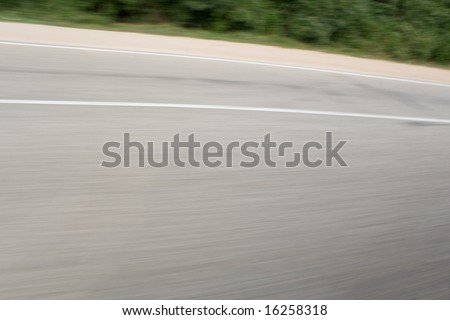 Snapshot of asphalt made from a car heading at high speed