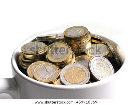 Snapshot of white cup filled of euro coins