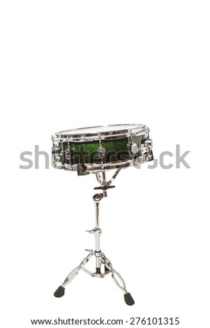 Snare drum at the front on a white background with drumsticks on it - stock photo