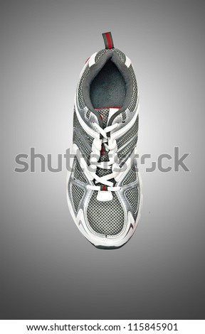 Sneaker isolated on grey background - stock photo