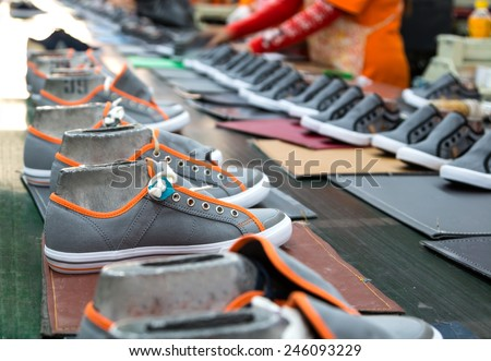 sneaker shoe making in footwear industry - stock photo