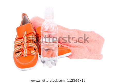 sneakers, a towel and a bottle of water isolated on white background - stock photo