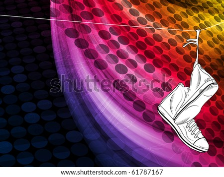 Sneakers hanging on telephone line with colorful background - stock photo
