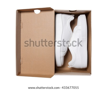 sneakers in the box, stylish shoes isolated on white - stock photo