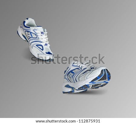 Sneakers isolated on grey background - stock photo