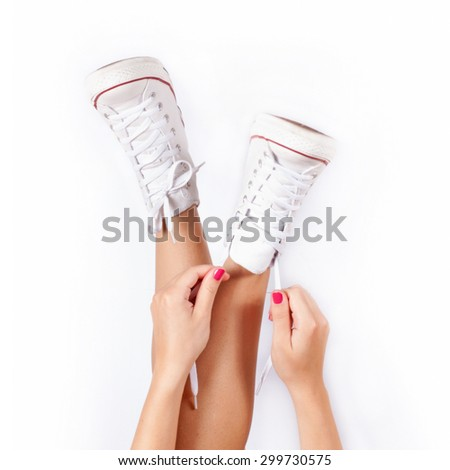 Sneakers on women legs - stock photo
