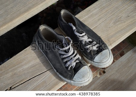 Sneakers shoes on wooden floor - stock photo