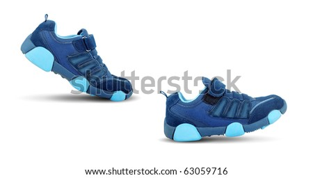 Sneakers walking by themselves isolated on white background - stock photo
