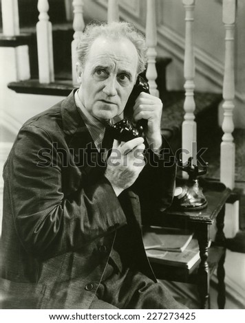 Sneaking in a phone call - stock photo