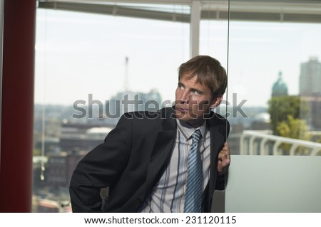 Sneaky Businessman - stock photo