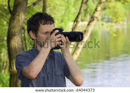 Sneaky photographer getting his shot of nature - stock photo