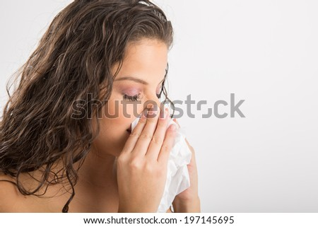Sneezing cute woman - stock photo