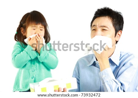 sneezing father and daughter - stock photo