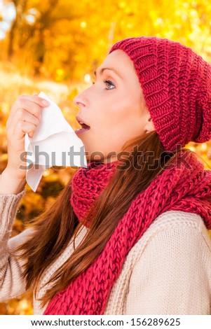 sneezing female in tissue girl - stock photo