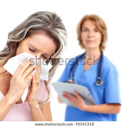 Sneezing girl and doctor. Isolated on white background. - stock photo