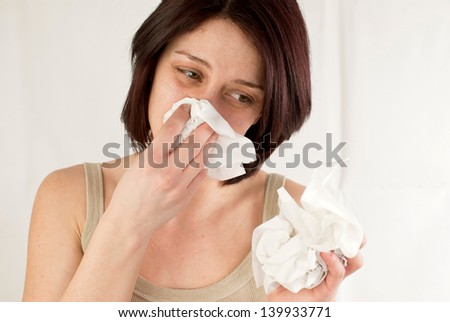 sneezing woman holding tissues, allergy or cold flu concept