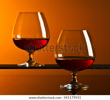 Snifter with brandy on a dark background