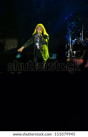 SNINA, SLOVAKIA - AUGUST 10: Andi Deris - singer of the metal band Helloween performs on music festival Rock pod Kamenom in Snina, Slovakia on August 10, 2013 - stock photo