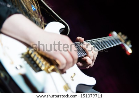 SNINA, SLOVAKIA - AUGUST 9: close-up of Matias Kupiainen - guitarist of Finnish power metal band Stratovarius playing guitar on music festival Rock pod Kamenom in Snina, Slovakia on August 9, 2013 - stock photo