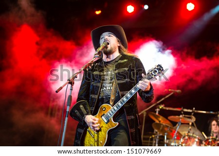 SNINA, SLOVAKIA - AUGUST 10: Singer and guitarist Robert Kodym of the band Wanastowi Vjecy performs on music festival Rock pod Kamenom in Snina, Slovakia on August 10, 2013 - stock photo