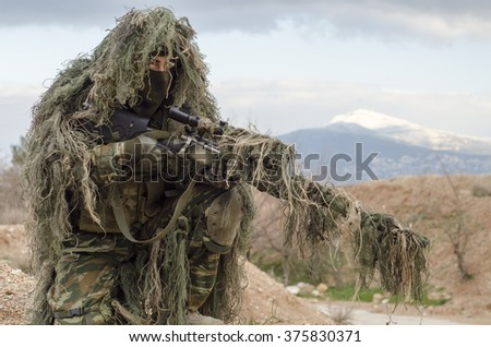 Sniper ghillie stand and target recognise  - stock photo