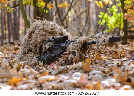 Sniper hide in forest with large caliber rifle