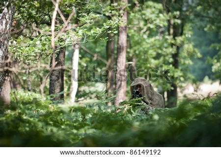 sniper in forest - stock photo