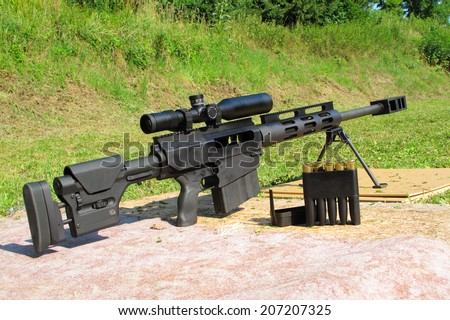 Sniper rifle .50 BMG caliber with riflescope for long range. - stock photo
