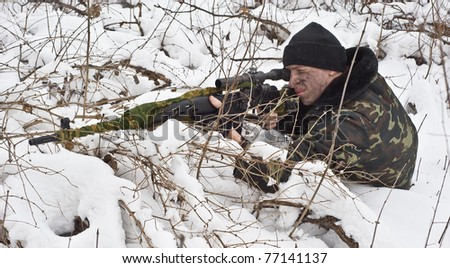 sniper rifle to the position.warrior in the winter forest.military action. - stock photo