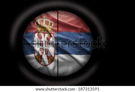 Sniper scope aimed at the Serbian flag