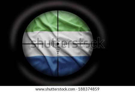 Sniper scope aimed at the Sierra Leone flag - stock photo