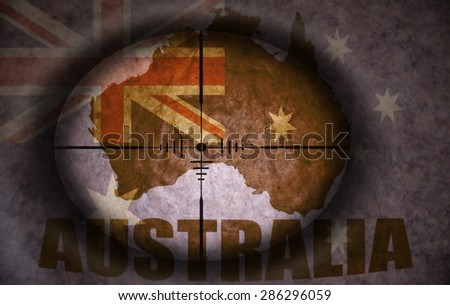 sniper scope aimed at the vintage australian flag and map - stock photo