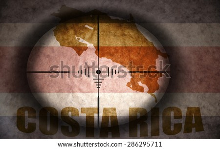 sniper scope aimed at the vintage costa rica flag and map - stock photo