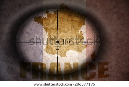 sniper scope aimed at the vintage french flag and map - stock photo