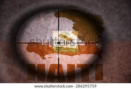 sniper scope aimed at the vintage haitian flag and map - stock photo