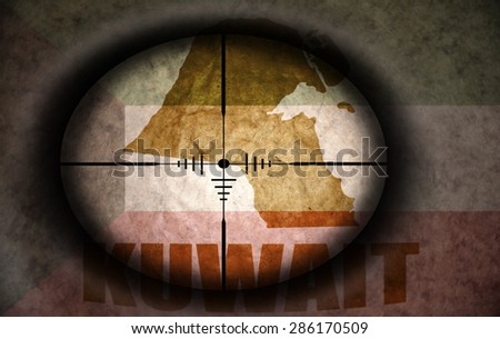 sniper scope aimed at the vintage kuwait flag and map - stock photo