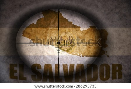sniper scope aimed at the vintage salvadoran flag and map - stock photo