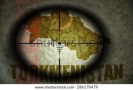 sniper scope aimed at the vintage turkmenistan flag and map - stock photo