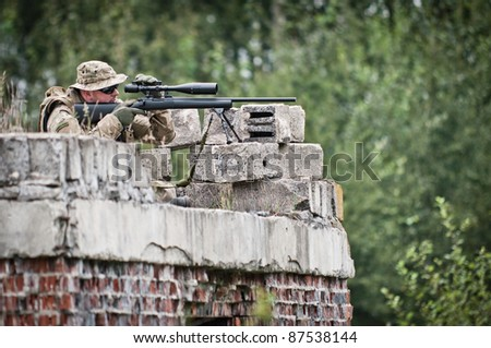 Sniper seeking target - stock photo