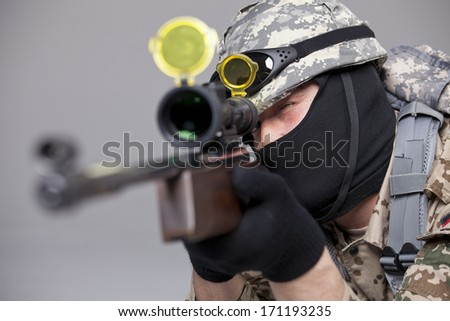 Sniper shooting - military scene making in a studio - stock photo