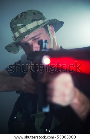 Sniper with aiming laser gun.