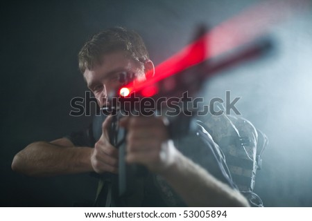 Sniper with aiming M16 laser gun.