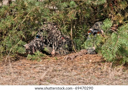 Sniper with rifle hidden in bushes, with observer, precise shoot, confirmed kill. - stock photo