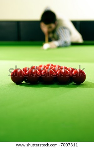 snooker player hitting a ball, shallow depth of field - stock photo