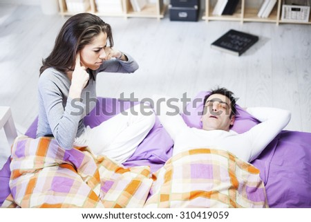 Snoring man. Couple in bed, man snoring and woman can not sleep, - stock photo