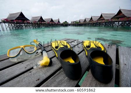 snorkel equipment in front of resort - stock photo